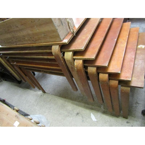29 - SEVEN STACKING TABLES