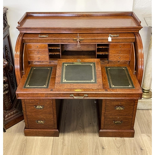1021 - Antique Oak twin pedestal roll top desk, pull out leather topped writing slide, approx 118cm H x 122...
