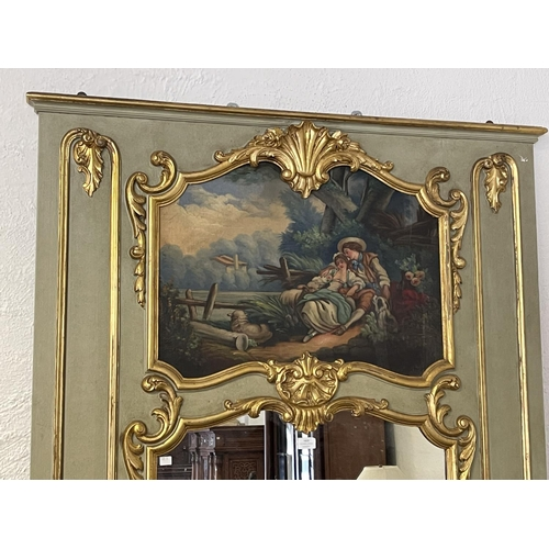 1023 - French pier mirror in green & gilt highlighted, hand painted panel of courting couple & sheep, appro...