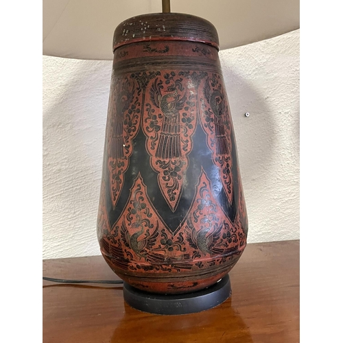 1030 - Pair of South East Asian red and black lacquer lidded containers converted to lamp, approx 66cm x 30...