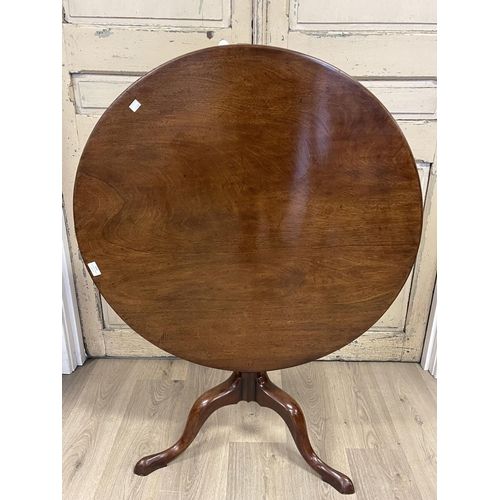 1039 - Antique English George III circular snap top tea table, held by a central turned fluted column, appr...