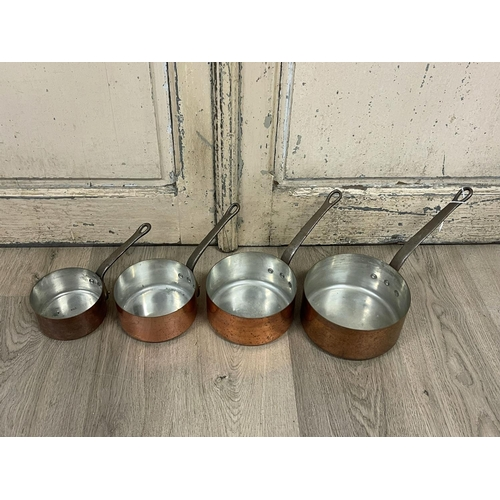 1042 - Set of four French copper and iron handled saucepans, stamped Fabrication France, approx 18cm Dia an...