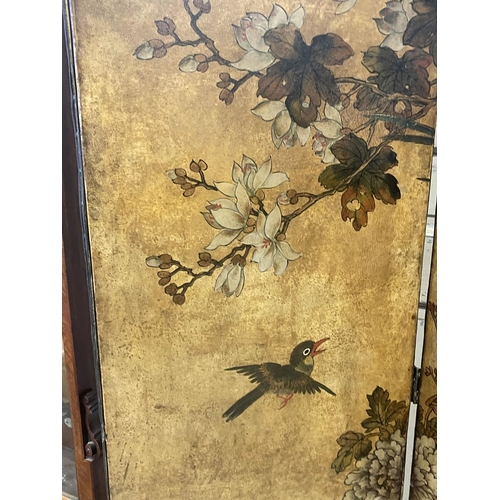 1051 - Antique four fold floor screen, painted leather and canvas backed, with studded trim, showing exotic...