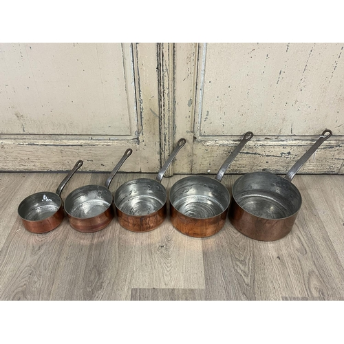 1044 - Set of five French copper sauce pans, of graduating size, iron handles, approx 20cm Dia and smaller ...