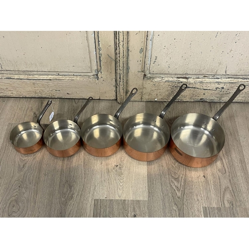 1046 - Set of five French copper sauce pans, stamped Tournus to handles, approx 30cm Dia and smaller (ex ha...