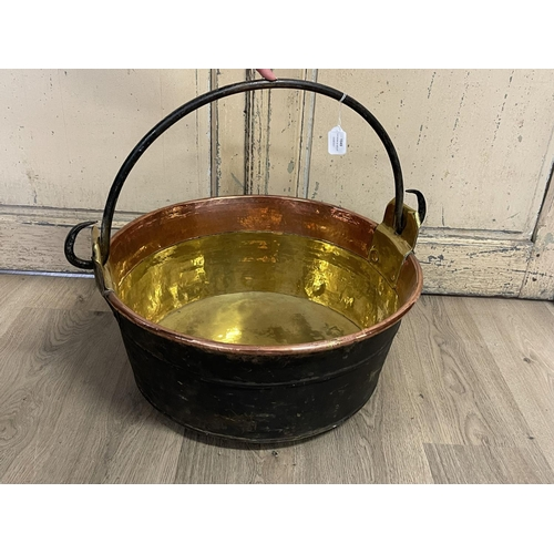 1049 - Antique 19th century French copper and brass pot of large size, with a wrought iron swing handle, 53...