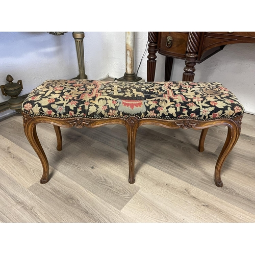 1031 - Antique French Louis XV revival carved oak  six leg stool, with studded wool work upholstery, approx...