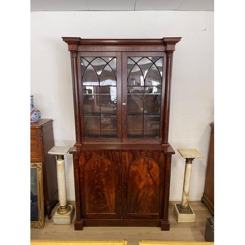 1032 - Antique Austral glazed mahogany combination bookcase secretaire, of inverted breakfront design, fitt...