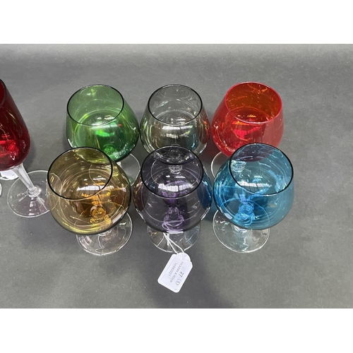27 - Set of harlequin coloured glass brandy balloons and a pair red glass wines, approx 18cm and smaller ...