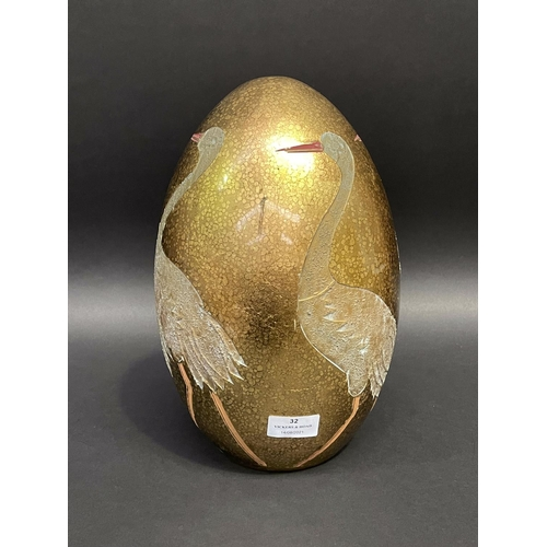 32 - Decorative egg shaped ornament, decorated with incised waterbirds, approx 32cm H