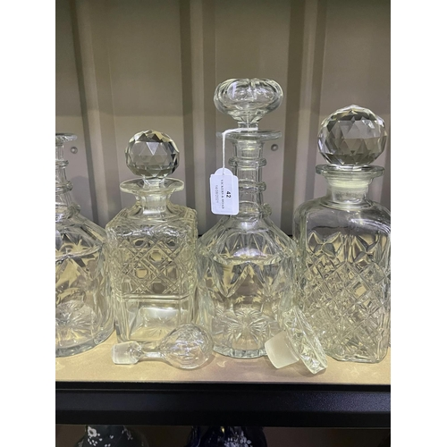 42 - Assortment of glass and cut crystal decanters and loose stoppers decanters, approx 26cm and smaller ...