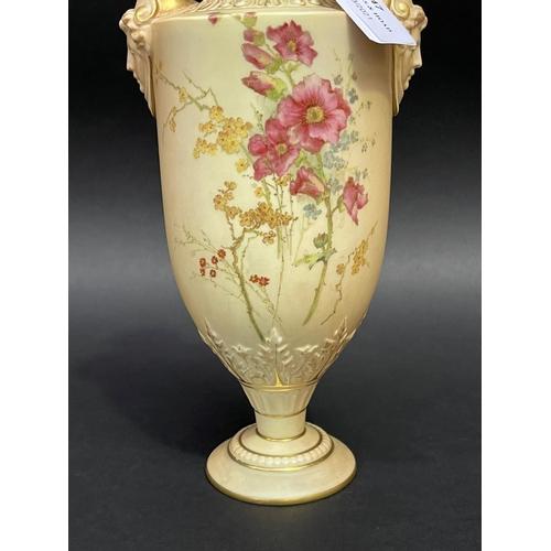 47 - Twin handle blush ivory mask head urn, approx 27cm H x 9cm W