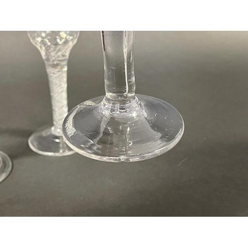 1002 - Three antique English Georgian wine glasses, one of trumpet shape with tear drop stem, air twist ste...