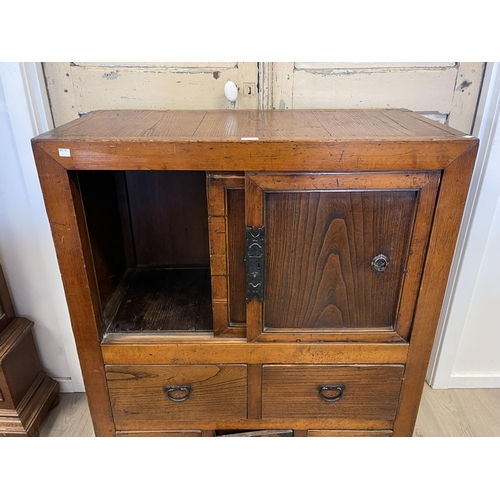 1012 - Antique Japanese Tansu cabinet, with iron mounts and handles, lower central lockable tea storage dra...