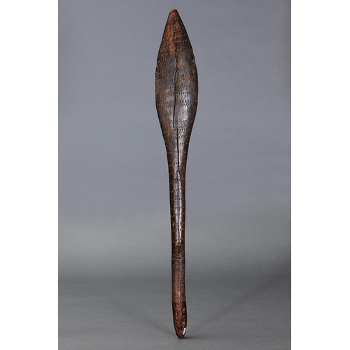 1019 - EARLY INCISED CLUB, VICTORIA, Carved and engraved hardwood (with custom stand) Wooden club, tapered ...