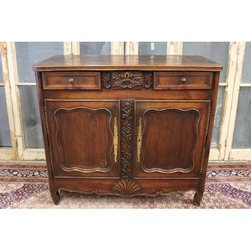 13 - Antique French Louis XV style buffet, two doors below three drawers, carved floral motif in relief w...