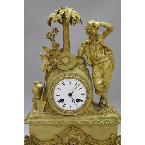 54 - Fine antique 19th century French gilt bronze figural mantle clock, young gent leaning against palm t...