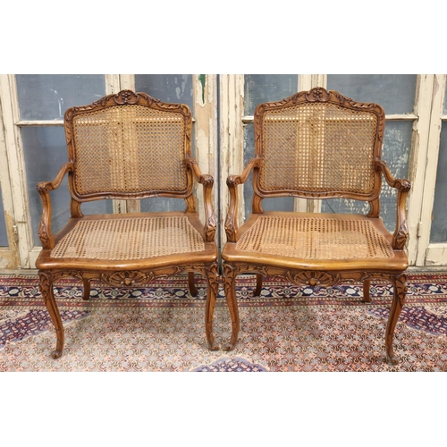 Pair of fine antique French Louis XV style armchairs, cane backs & seats, large wide saddle (2)