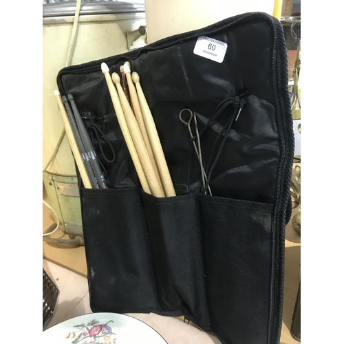 60 - Drum sticks in case...